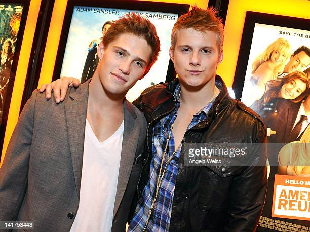 Actor Alexander Ludwig and guest arrive at 'The Hunger Games' opening night midnight showing at Regal 14 at LA Live Downtown on March 22 2012 in Los...