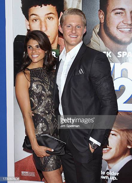 Actor Alexander Ludwig and guest attend the 'Grown Ups 2' New York Premiere at AMC Lincoln Square Theater on July 10 2013 in New York City