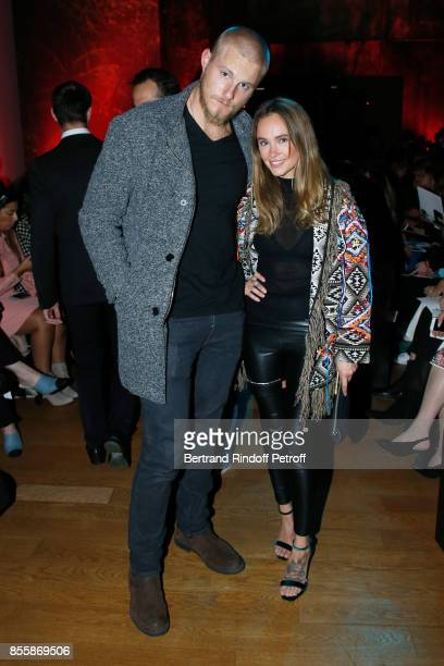 Actor Alexander Ludwig and Kristy Dawn Dinsmore attend the Elie Saab show as part of the Paris Fashion Week Womenswear Spring/Summer 2018 on...