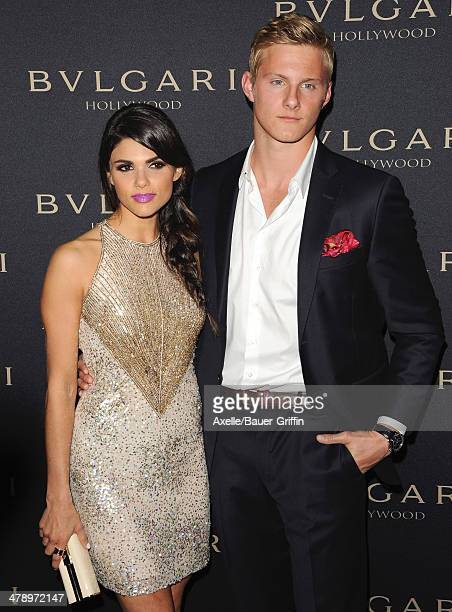 Actor Alexander Ludwig and Nicole Pedra arrive at BVLGARI 'Decades Of Glamour' Oscar Party Hosted By Naomi Watts at Soho House on February 25 2014 in...