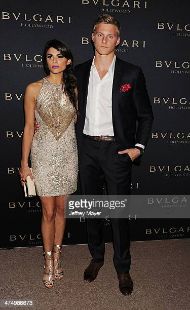 Actor Alexander Ludwig and Nicole Pedra arrive at the BVLGARI 'Decades Of Glamour' Oscar Party Hosted By Naomi Watts at Soho House on February 25...