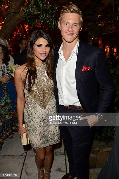 Actor Alexander Ludwig and Nicole Pedra attend 'Decades of Glamour' presented by BVLGARI on February 25 2014 in West Hollywood California