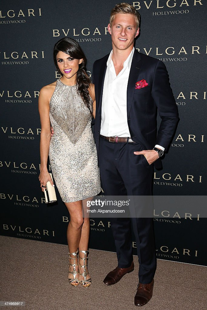 Actor Alexander Ludwig (R) and Nicole Pedra attend the BVLGARI 'Decades of Glamour' Oscar Party at Soho House on February 25, 2014 in West Hollywood, California.