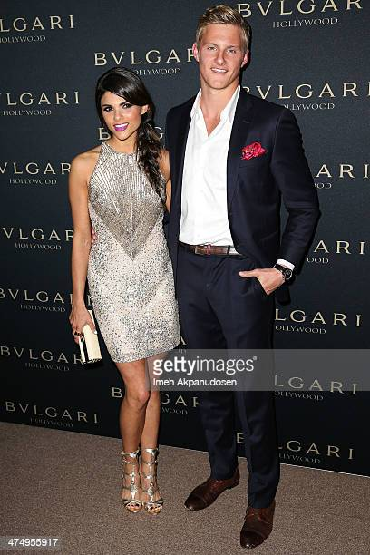 Actor Alexander Ludwig and Nicole Pedra attend the BVLGARI 'Decades of Glamour' Oscar Party at Soho House on February 25 2014 in West Hollywood...