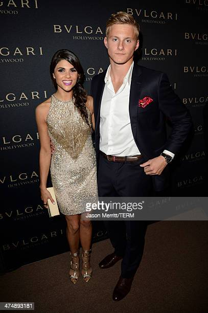 Actor Alexander Ludwig and Nicole Pedra attends 'Decades of Glamour' presented by BVLGARI on February 25 2014 in West Hollywood California