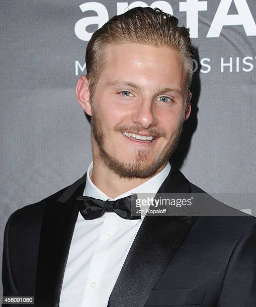 Actor Alexander Ludwig arrives at the 2014 amfAR LA Inspiration Gala at Milk Studios on October 29 2014 in Hollywood California