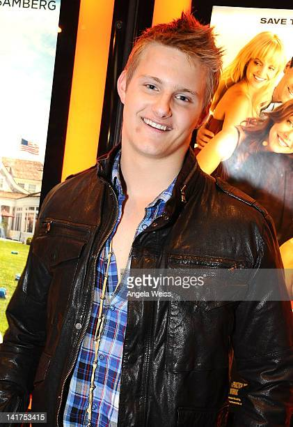 Actor Alexander Ludwig arrives at 'The Hunger Games' opening night midnight showing at Regal 14 at LA Live Downtown on March 22 2012 in Los Angeles...