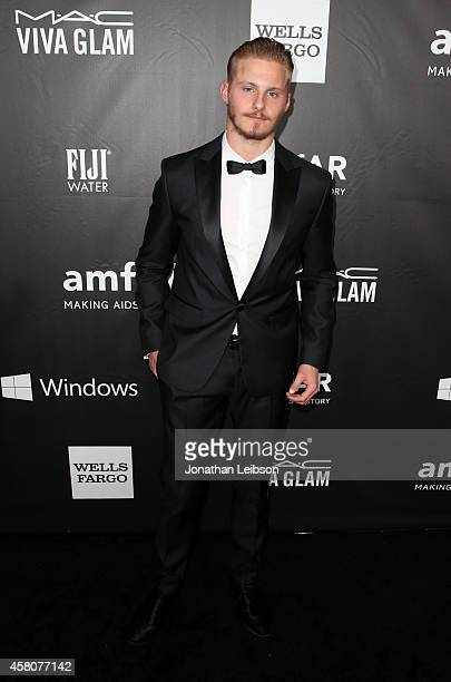 Actor Alexander Ludwig attends amfAR LA Inspiration Gala honoring Tom Ford at Milk Studios on October 29 2014 in Hollywood California