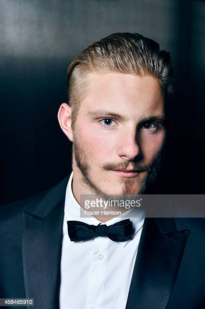 Actor Alexander Ludwig poses for a portrait at the amfAR LA Inspiration Gala on October 29 2014 in Los Angeles California