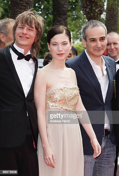 Actor Alexander Scheer Actress Nora Von Waldstaetten and Director Olivier Assayas attends the 'Carlos' Premiere at the Palais des Festivals during...