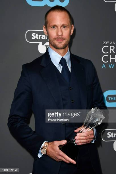 Actor Alexander Skarsgaard poses with the award for Best Supporting Actor in a Movie Made for TV or Limited Series for 'Big Little Lies' in the press...