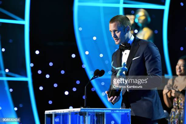 Actor Alexander Skarsgard accepts the award for 'Outstanding Performance by a Male Actor in a Television Movie or Limited Series' onstasge during the...