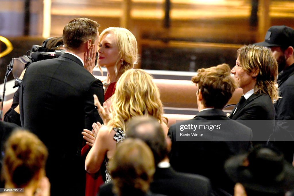 Actor Alexander Skarsgard goes to accept Outstanding Supporting Actor in a Limited Serier or Movie for 'Big Little Lies' as actress Nicole Kidman congratulates him as Keith Urban looks on during the 69th Annual Primetime Emmy Awards at Microsoft Theater on September 17, 2017 in Los Angeles, California.