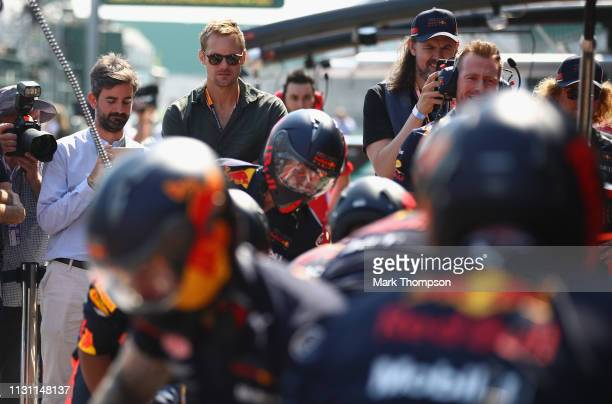 Actor Alexander Skarsgard looks on as the Red Bull Racing team practice pit stops before the F1 Grand Prix of Australia at Melbourne Grand Prix...
