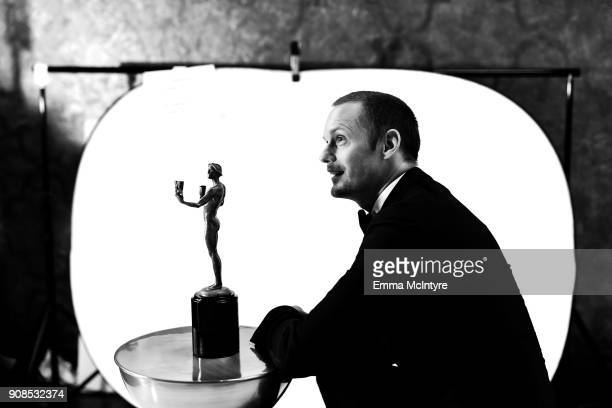 Actor Alexander Skarsgard poses with award for Outstanding Performance by a Male Actor in a Miniseries or Television Movie backstage at the 24th...