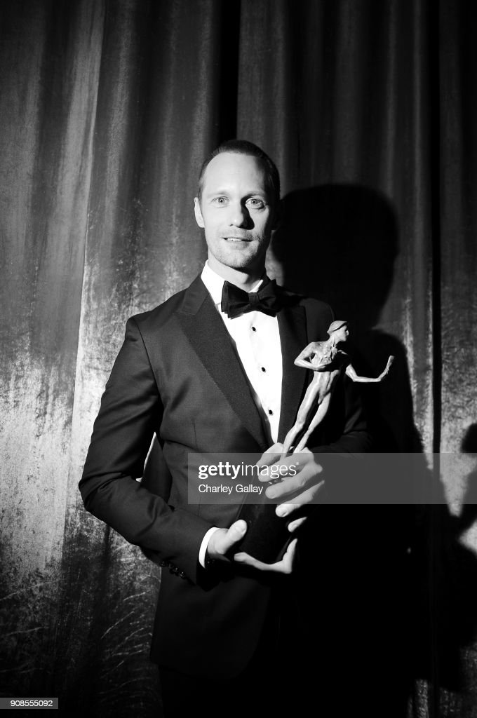 Actor Alexander Skarsgard poses with award for Outstanding Performance by a Male Actor in a Miniseries or Television Movie backstage during the 24th Annual Screen Actors Guild Awards at The Shrine Auditorium on January 21, 2018 in Los Angeles, California. 27522_008