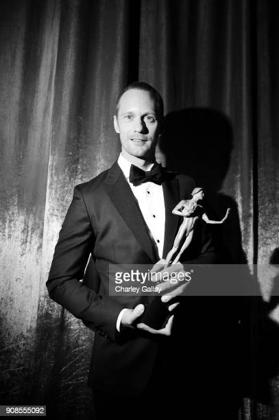 Actor Alexander Skarsgard poses with award for Outstanding Performance by a Male Actor in a Miniseries or Television Movie backstage during the 24th...