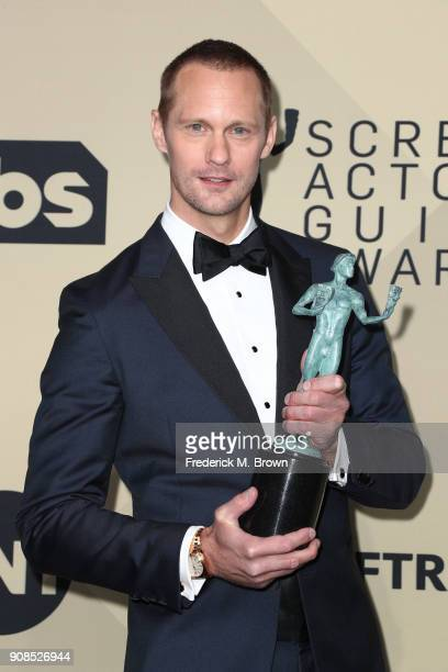 Actor Alexander Skarsgard winner of Outstanding Performance by a Male Actor in a Television Movie or Limited Series for 'Big Little Lies' poses in...