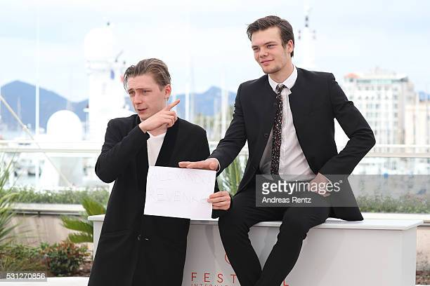 Actor Alexandr Gorchilin and Petr Skvortsov pose with a poster for Alexandra Revenko attend the 'The Student' Photocall during the 69th annual Cannes...