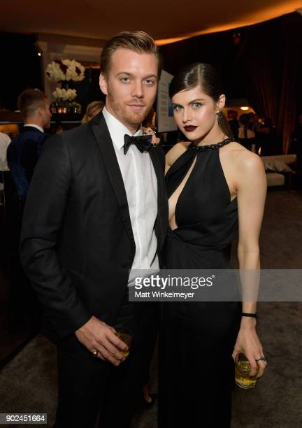 Actor Alexandra Daddario and guest attend the 2018 InStyle and Warner Bros 75th Annual Golden Globe Awards PostParty at The Beverly Hilton Hotel on...