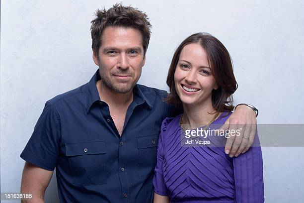 "Actor Alexis Denisof and actress Amy Acker of ""Much Ado About Nothing"" pose at the Guess Portrait Studio during 2012 Toronto International Film..."