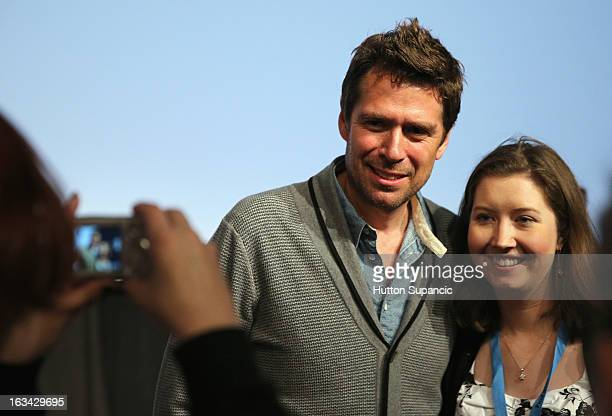 Actor Alexis Denisof poses with a fan at the Much Ado About Much Ado Panel during the 2013 SXSW Music Film Interactive Festival at Austin Convention...