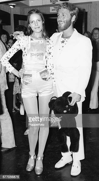 Actor Alexis Kanner and his model girlfriend Annie Lambert dressed in dungaree shorts attend the premiere of the film 'Goodbye Gemini' at the London...