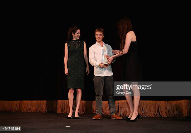 Actor Alfie Allen accepts his Rising Star Award from Caroline and Rebecca Huey during Day Four of 18th Annual Savannah Film Festival Presented By...