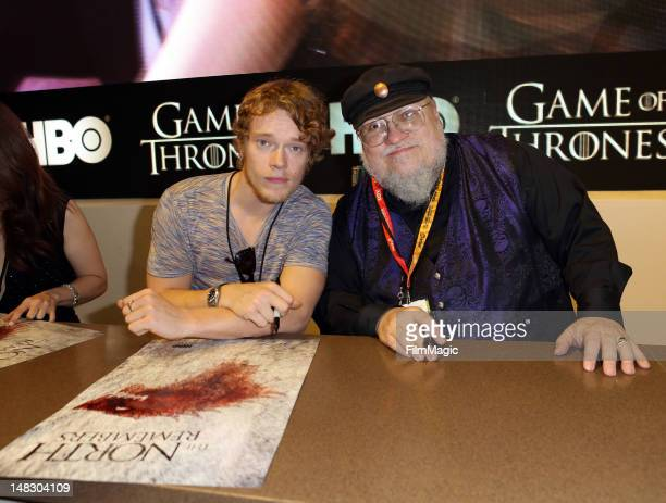 "Actor Alfie Allen and writer George R.R. Martin sign autographs for HBO's ""Game Of Thrones"" during Comic-Con International 2012 at San Diego..."