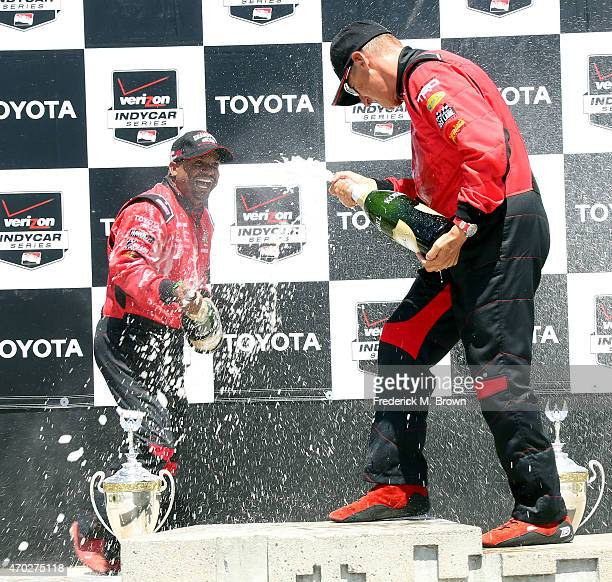 Actor Alfonso Ribeiro celebrates after winning the 38th Annual Toyota Pro/Celebrity Race and Dave Pasant finished in second place at the Grand Prix...