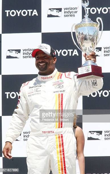 Actor Alfonso Ribeiro celebrates after winning the celebrity race of the 42nd Toyota Grand Prix of Long Beach on April 16 2016 in Long Beach...