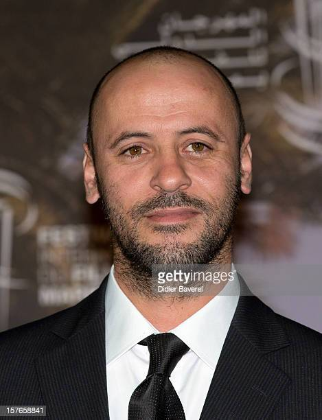 Actor Ali Suliman poses during a photocall for the movie ' The Attack' at 12th International Marrakech Film Festival on December 5 2012 in Marrakech...