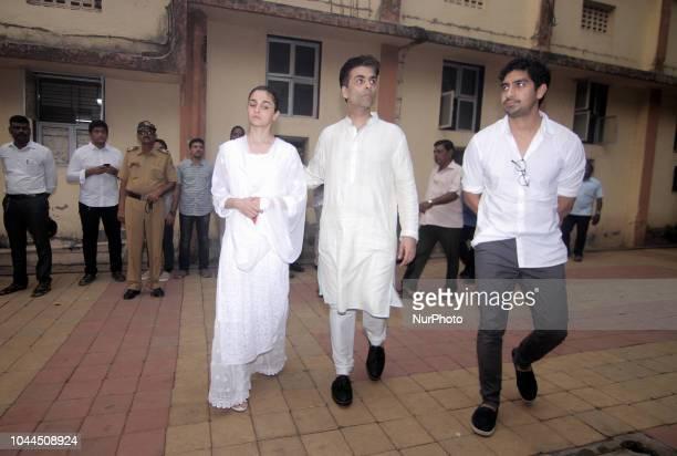 Actor Alia Bhat Director Karan Johar and Director Ayan Mukerji during the funeral of late Krishna Raj Kapoor who passed away of cardiac arrest in...