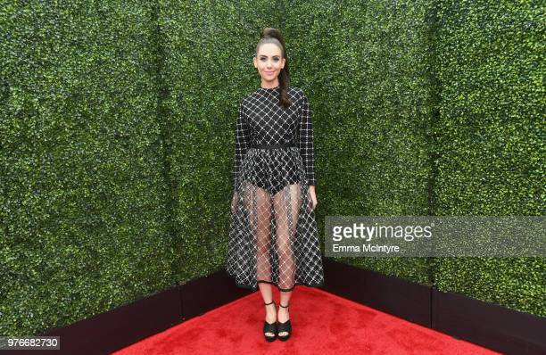 Actor Alison Brie attends the 2018 MTV Movie And TV Awards at Barker Hangar on June 16, 2018 in Santa Monica, California.