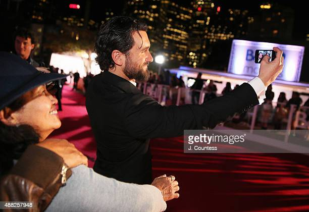 Actor Allan Hawco takes a photo with a fan at the 'Hyena Road' premiere during the 2015 Toronto International Film Festival at Roy Thomson Hall on...