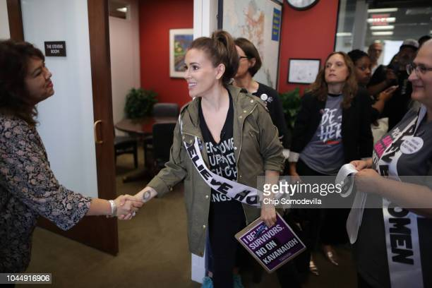 Actor Alyssa Milano greets Angelina EstradaBurney administrative services director for Sen Lisa Murkowski as a large group of protesters visit...