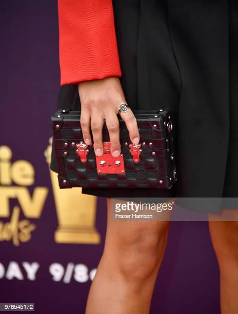 Actor Amandla Stenberg clutch detail attends the 2018 MTV Movie And TV Awards at Barker Hangar on June 16 2018 in Santa Monica California