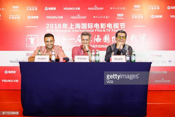 Actor Amir Jadidi Far Ali Haji Ghasemi and director Ramtin Lavafi Pour attend a press conference of Iranian film 'Hattrick' during the 21st Shanghai...