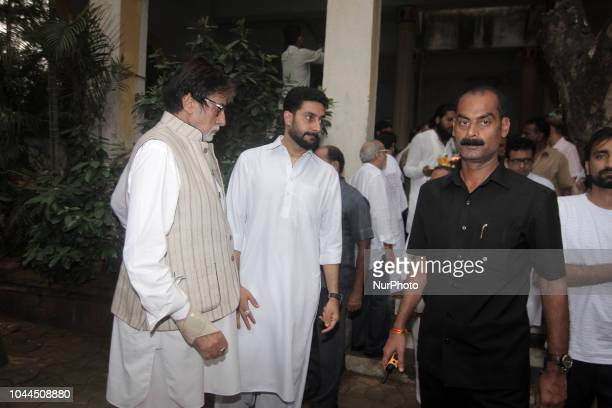 Actor Amitabh Bachchan and Abhishek Bachchan during the funeral of late Krishna Raj Kapoor who passed away of cardiac arrest in Mumbai on October 01...
