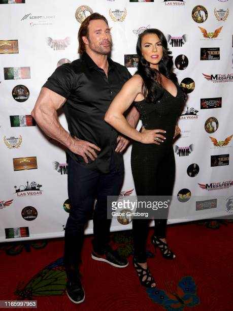 Actor and bodybuilder Mike O'Hearn and fitness instructor Mona Muresan attend the Action on Film MEGAFest International Film Festival at the Rio...