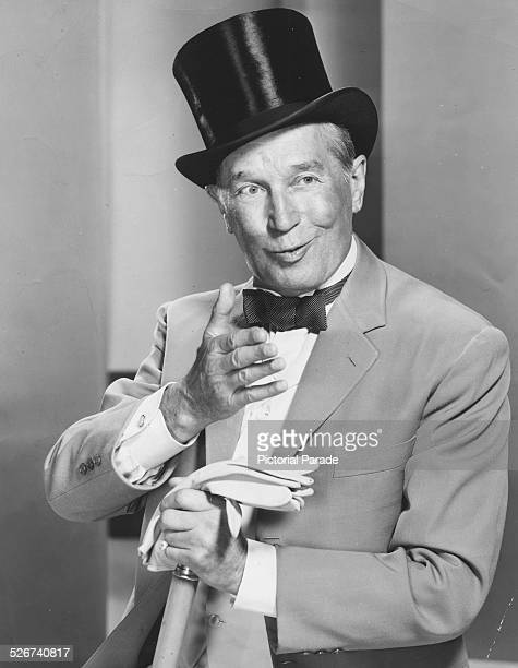 Actor and cabaret star Maurice Chevalier wearing a top hat and bowtie as he appears in the film 'Gigi' 1958