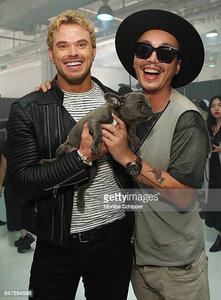 Actor and CFDA ambassador for NYFWM Kellan Lutz visits designer Bumsuk Choi and his dog Sundea backstage after the General Idea fashion show during...