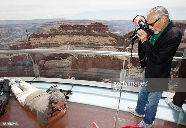 Actor and chair of the CineVegas creative advisory board Dennis Hopper photographs Danny Greenspun at the Grand Canyon Skywalk June 12 2009 in Grand...