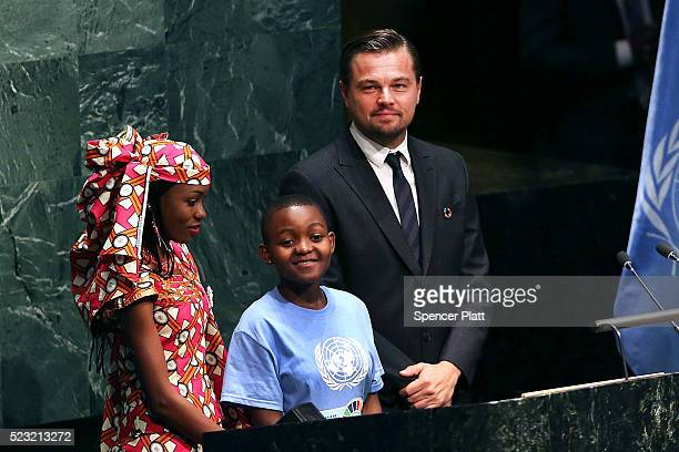 Actor and climate activist Leonardo DiCaprio stands with children at the United Nations Signing Ceremony for the Paris Agreement climate change...