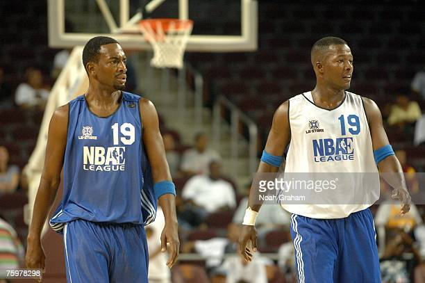 Actor and comedian Bill Bellamy walks up court with actor Flex Alexander as they play in the LA Stars Celebrity AllStar Game at the USC Galen Center...