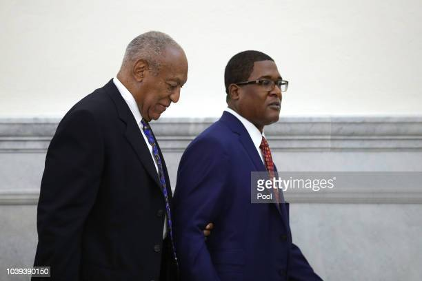 Actor and comedian Bill Cosby is led from the courtroom during a break by his spokesman Andrew Wyatt at the Montgomery County Courthouse during his...