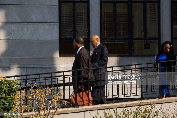 Actor and comedian Bill Cosby leaves with his spokesman Andrew Wyatt after a pretrial hearing for his sexual assault trial at the Montgomery County...