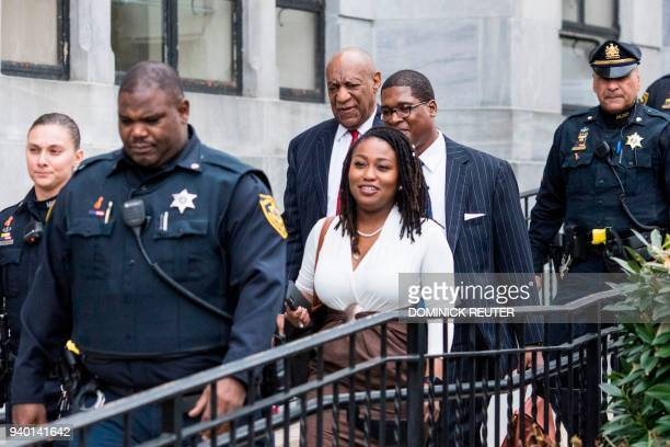Actor and comedian Bill Cosby leaves with his spokesman Andrew Wyatt after a pretrial hearing in the sexual assault trial against actor and comedian...