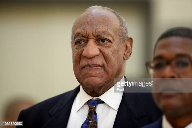Actor and comedian Bill Cosby returns to the courtroom after a break with his spokesman Andrew Wyatt at the Montgomery County Courthouse during his...
