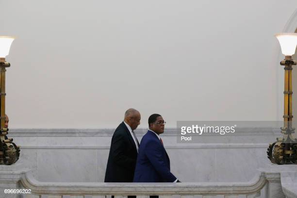 Actor and comedian Bill Cosby walks with his publicist Andrew Wyatt during the fifth day of deliberations in Bill Cosby's sexual assault trial at the...